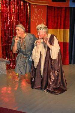 Pseudolus (Leonard King) and his master Senex (Eddie Docherty) get a moment of respite from the chaos.