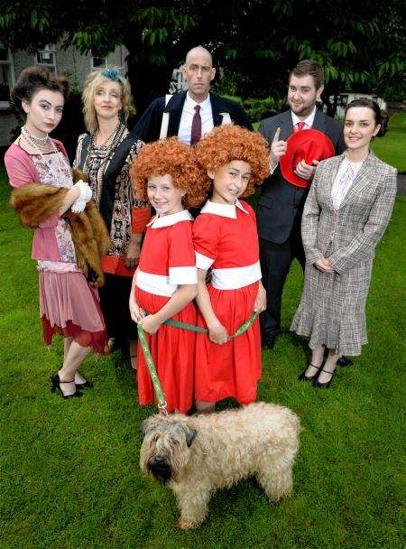 The cast - Annies Tyra McLoughlin and Erin Moran with dog Jazz, Lily St Regis (Molly MacKay),Miss Hannigan (Fiona Chapman),Warbucks (Garry Black), Rooster (Liam MacAskill) and Grace Farrell ( Alison Ozog). Picture: Gary Anthony
